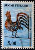 Finland-circa 1977: A Stamp Printed In The Finland, Shown Kirvu Weather Vane, Circa 1977
