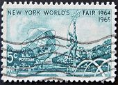 a stamp shows Mall with Unisphere and rocket thrower by Donald De Lue from New York World