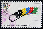 A stamp printed in the USA shows XI Olympic Winter Games Sapporo 1972