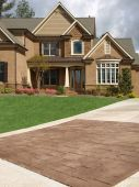 Luxury Model Home Exterior Stone Driveway