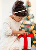 holidays, presents, christmas, x-mas concept - happy child girl with gift box