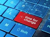 Time concept: Clock and Time for Change on computer keyboard bac