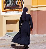 Christian nuns walking down the street