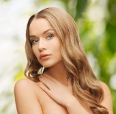 health and beauty, eco, bio, nature concept - face of beautiful woman with long hair