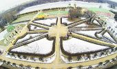 Pathes in park and pond of museum-estate Kuskovo at winter, Moscow, Russia. Aerial view