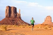 Runner. Running man sprinting in Monument Valley. Athlete runner cross country trail running outdoor