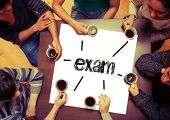 Student drinking coffee sitting around page saying the word exam