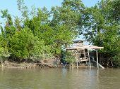 Abandoned boat on Sungai Santubong riverbank