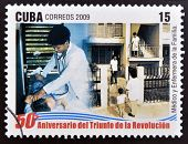 stamp 50 anniversary of the triumph of the revolution shows physician and family nurse