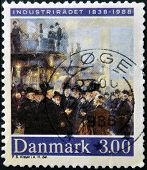 A stamp printed in Denmark dedicated to industrialization shows a meeting of wealthy capitalists
