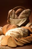 Assortment Of Baked Bread Over Brown Background