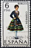 A stamp printed in Spain dedicated to Provincial Costumes shows a woman from Burgos
