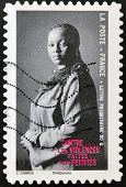 A stamp printed in France dedicated to combating violence against women
