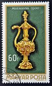 A stamp printed in Hungary shows Altar burette 1500