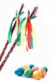 stock photo of flogging  - Czech rod with Easter eggs on white background - JPG