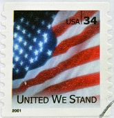 stamp shows image of the US flag United We Stand