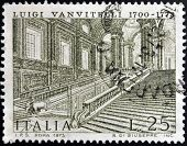 A stamp printed in Italy shows Caserta Royal Palace by Luigi Vanvitelli