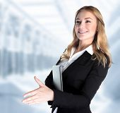 Closeup portrait of cute girl holding laptop and stretches out her hand for a handshake with business partner, make a deal concept