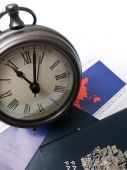 Clock on travel documents and passport