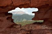 "picture of siamese  - Pikes Peak as seen through the ""window"" in the lower portion of the Siamese Twins in Garden of the Gods Park, Colorado Springs, Colorado USA