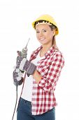 Young casual woman holding drill and wearing safety helmet. Isolated on white.