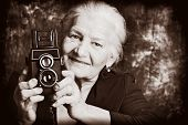 pic of old lady  - Portrait of a beautiful old lady with her old camera - JPG