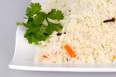 stock photo of ghee  - Indian Ghee rice on white plate isolated - JPG