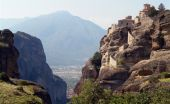 foto of olden days  - The ancient monastery costs on a rock against mountains - JPG