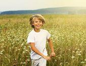 Happy boy running on summer field