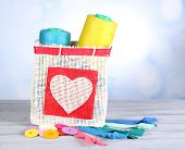 stock photo of lurex  - Colorful bobbins of thread  in bag - JPG