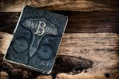 Antique Family Bible On Rustic Table