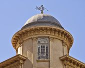 classical building dome detail with Triton (ancient Greek deity) as wind vane