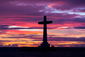 foto of camiguin  - Catholic cross silhouette in the sunken cemetery at dusk - JPG