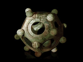 picture of dodecahedron  - Ancient bronze Roman dodecahedron on a black background - JPG