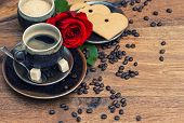 Cup Of Black Coffee With Red Rose Flower And Heart Cake