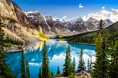 stock photo of green-blue  - Landscape sunset view of Morain lake and mountain range Alberta Canada - JPG