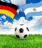 Soccer Ball On Grass And Flags Of Germany And Argentina