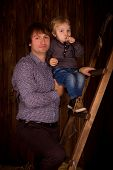 Father And Son In A Wooden Interior