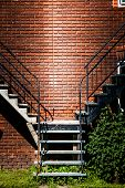 foto of merge  - Symmetrical Staircases merging together and brick wall - JPG