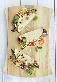 foto of portobello mushroom  - Tacos filled with roasted portobello mushrooms zucchini and purple onions with cherry tomatoes cilantro and monterrey jack cheese - JPG