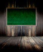 Abstract The Green Blackboard On Grunge Wall