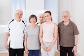 Confident Trainer And Senior Customers At Healthclub