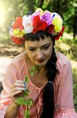 cute woman with a wreath of flowers on her head