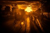 Riding rickshaw at sunset