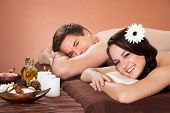 Smiling Couple Relaxing In Beauty Spa