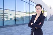 Beautiful Business Woman Standing On Street Against Modern Office Building
