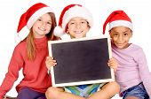 foto of little kids  - little kids with christmas hats isolated in white - JPG