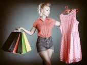 Pinup Girl With Shopping Bags Buying Clothes