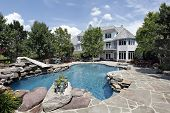 stock photo of swimming pool family  - Rear view of luxury home with swimming pool - JPG