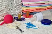 Nipple, bottle, scissors, diapers, clothes, enema, cotton swab